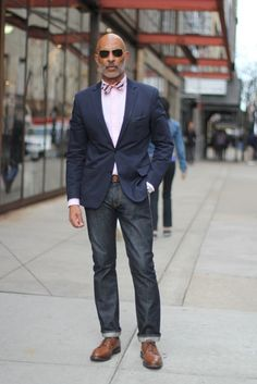 Shop this look on Lookastic: http://lookastic.com/men/looks/jeans-derby-shoes-belt-dress-shirt-bow-tie-blazer/766 — Charcoal Jeans — Tan Leather Derby Shoes — Brown Leather Belt — Pink Dress Shirt — Pink Horizontal Striped Bow-tie — Navy Blazer