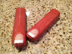 Stick press-on nails in hot dogs.