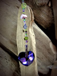 Items similar to Swarovski Crystals Suncatcher in Forest Faerie Colors on Etsy