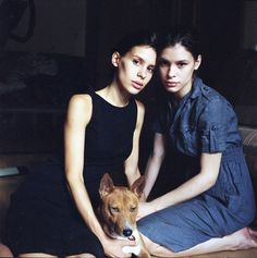 Two girls with a basenji.