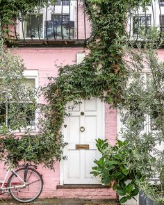A pink house in a Notting Hill mews street in London. This house was used in the Notting Hill movie, too. #nottinghill #london #house #pink #door