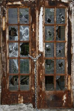 Abandoned....love the padlocked chain (on the door with all the broken window glass;)