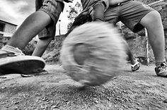 Young people playing football in the community in the suburbs.