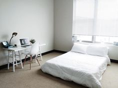 """""""My bedroom (and apartment in general) is still a maaajor work in progress. I need to get a bed frame, but I've been sleeping so well on my Tuft & Needle mattress even with it just on the floor at the moment. I love waking up every morning in this white-filled and light-filled room."""""""