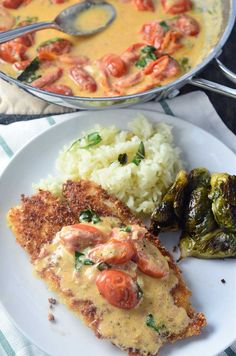 Parmesan crusted tilapia with tomato-basil cream sauce is a quick and easy dinner recipe that the whole family will love. Pan fried tilapia with Parmesan and panko breading, is topped with a delectable creamy tomato-basil sauce. Breaded Tilapia, Pan Fried Tilapia, Parmesan Crusted Tilapia, Breaded Chicken, Fish Recipes, Seafood Recipes, Cooking Recipes, Pisces, Desserts