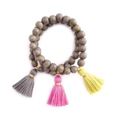 Gray wood stretchy bracelet with choice of tassel color Continue reading →