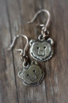 Earrings | Paarma Design      National animal of Finland has power.  King of the forests is a symbol of good luck and woodlands.