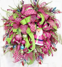 Hot Pink & Lime Green Deco Mesh Door Wreath With Whimsical Pink Santa and glistening ornaments and fillers.  Four Ribbons in addition to Deco... by http://www.LadybugWreaths.com, $249.97