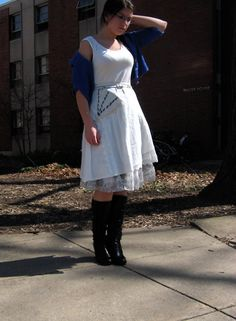 dainty white dress, handknit shawl, and knee high boots