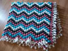 Get ready for a wool-eater! This would be great to use up some scrap yarn. Colors are changed every 2 rows. Have fun!