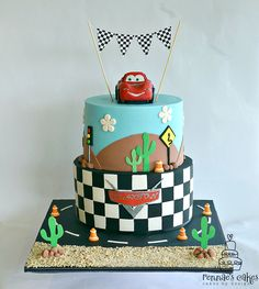 Lightening McQueen from Cars themed cake. Checkerboard bottom tier, with non edible checkered flag bunting, hand molded fondant Lightening with edible image stickers.