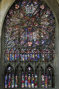 gothic ornamentation focused heavily on religious iconography so most photos in this board include elements from religious buildings, much like this stained glass window seen here. Stained Glass Church, Stained Glass Angel, Stained Glass Windows, Cathedral Architecture, Baroque Architecture, Amazing Architecture, L'art Du Vitrail, Rose Window, Church Windows