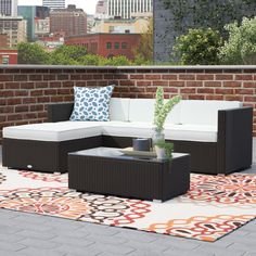 Outfit your alfresco ensemble in sophisticated style with this five-piece all-weather rattan seating group, featuring two corner chairs, an armless chair, one chaise seat, and one coffee table. Its woven wicker details bring breezy flair to any space while its foam-filled cushions add a cozy layer to your patio arrangement. Round out your outdoor arrangement by pairing this set with a metal bistro table and two stools, perfect for enjoying a dinner under-the-stars with that special someone…