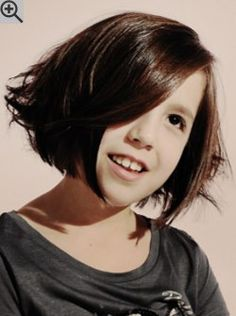 Fashionable bob haircut for kids. The cutting lines run bluntly along the jaw line and curve at the chin.