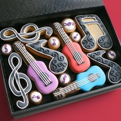 Great notes, treble clef and guitar cookies with easy little thumbprint notes.