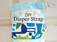 Check out this tutorial for a DIY diaper strap from Haley of Grey House Harbor. Not only is it cute, but it will keep those diapering essentials organized!