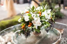 Orange, cream, green and blue centerpiece from Melanie Benson Floral. A Romantic European Wedding Experience at JM Cellars | Weddings in Woodinville, WA » Seattle Wedding Photographers and Destination Wedding P...