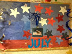 Work July birthday board.  Used old birthday decorations and scrapbooking and tissue paper.