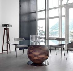 porada italy | gheo-k table. Design: E. Missaglia. Dining-table with base in solid canaletta walnut or ash fixed on a metal disc with tempered transparent glass top (centered, thickness mm. 12), chromed metal base.  http://www.spencerinteriors.ca/porada.html