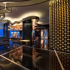 Iconic Restaurant Designs by Adam Tihany: The Gold Bullion Wall at Mandarin Oriental.