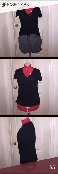 """Forever 21 V-Neck T-Shirt Forever 21 V-Neck T-Shirt EUC Size: Large Color: Navy or Black Fabric Composition: 60% Cotton 40% Modal Measurements when Flat: Bust: 18"""" Waist: 17"""" Length: 23"""" *No stretching. In excellent condition and was only worn a few times. Forever 21 Tops Tees - Short Sleeve"""