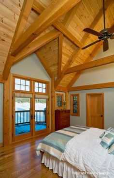 This lakeside master bedroom looks out over the lake.