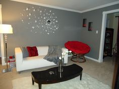 Grey living room with white and red accents