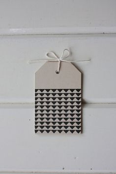 This geometric pattern is hand stamped on recycled light brown card tags with black archival ink. Triangle Pattern Gift Tags. Via Etsy.