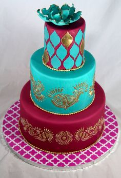 Love this color combination for a wedding or party: magenta, medium teal, and metallic gold.