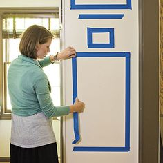 Layout your space...Taping off a wall to designate where your items will hang...GENIUS!