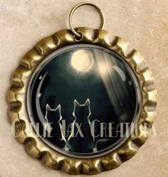 Cats bottle cap pendant. Yearning for the yarn moon. Great for purse charms, day planner charms, keychain charms and zipper pulls.