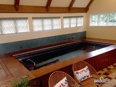 """Winters can be rough in Lancaster, Pennsylvania. Fortunately, this Endless Pool offers year-round access to warm-water swimming and splashing. By customizing the water depth to 45"""", the owners get more buoyancy and less joint impact when training on their Underwater Treadmill. They smartly saved space in a room with a sloped ceiling by cornering their pool, thanks to the internal components' easy accessibility from a single side."""