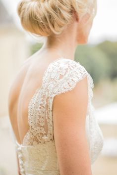 A pretty + delicate lace strap: http://www.stylemepretty.com/2016/02/17/romantic-wedding-dresses/: