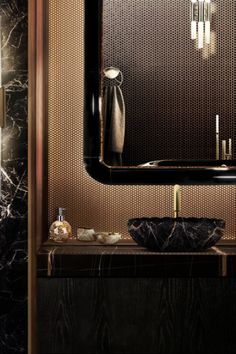 Black and gold, is there a more iconic match? The Lotus Vessel Sink in this luscious black marble perfectly combines with the Ring rectangular mirror. Ideal for a unique and exclusive home, it reflects elegance once it is on the bathroom or other space of the house.