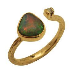 Billedresultat for slebet guld opal ring