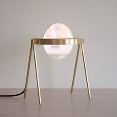Janus is a minimal table lamp created by Brooklyn-based designers Trueing. Janus, one of Saturn's outermost rings, as well as the two-faced, coin-gracing Roman deity of transitions, is the eponym and inspiration for Trueing's newest table lamp. Light Table, A Table, Online Lighting Stores, Contemporary Table Lamps, Brass Lamp, Diy Desk, Desk Lamp, Floor Lamp, Janus