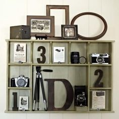Display old family photos with old photography equipment. Capture parts of the family tree.