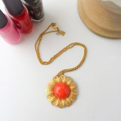 "18"" Vera Bradley John Wind Necklace Gold (faux gold) chain 18"" with a gold metal flower and orange middle.  Metal flower measures 1 ¾"" wide.  In great preowned condition.  Can be dressed up or down!  Comes from a smoke free and pet free home.  Open to offers.  Please no trades or paypal Vera Bradley Jewelry Necklaces"