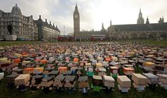 foldableme2 730x430 Thousands of tiny cardboard people stage a protest outside the Houses of Parliament in London