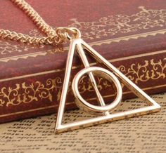 Gold Plated Harry Potter Deathly Hallows Pendant and Necklace #gold #harrypotter #deathlyhallows #elderwand #cloakofinvisibility #necklace #pendant #ladies #jewellery #cute #xmas #christmas #present http://m.ebay.co.uk/itm/Free-Gift-Bag-Harry-Potter-Deathly-Hallows-Pendant-Necklace-Xmas-/282145614975?nav=SELLING_ACTIVE&skus=Colour:Silver%20Plated&varId=581114509866