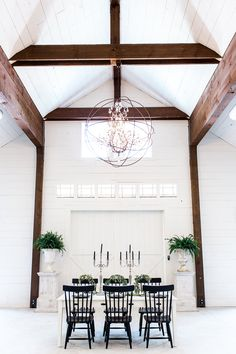 modern barn reception - photo by Olivia Morgan Photography http://ruffledblog.com/get-inspired-by-this-beautiful-wedding-cake-table
