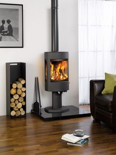The Dovre Astroline Pedestal Wood Burning Stove is a contemporary stove suitable for large open plan living spaces, while using the latest cleanburn technology and airwash system. The Dovre Astroline Pedestal Wood Burning Sto Log Burner Fireplace, Wood Burning Fireplace Inserts, Wood Burner, Log Burner Living Room, Interior Design Examples, Interior Design Inspiration, Room Inspiration, Modern Log Burners, Scandinavian Fireplace