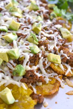 Baked Tostone Nachos using fried plantains instead of chips! Delicious toppings include ground beef picadillo, cheese and avocado! Carne Guisada Recipe Mexican, Broccoli Cheese Rice Casserole, Beef Picadillo, Nutella, Chocolate Tres Leches Cake, Pumpkin Flan, Easy Skillet Dinner, Bacon Wrapped Smokies, Coconut Flan