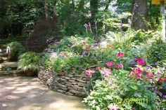 There's something about a stacked fieldstone wall that I adore. And the shade garden here is lovely.
