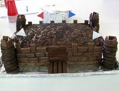 I made this castle cake with two 9x13 cakes, layered one on top of the other.  I used yellow cake mix and chocolate frosting, decorated with chocolate sprinkles and Hershey's chocolate bars.  The towers were chocolate filled chocolate cookies, glued with chocolate frosting.  The cake was a hit at the close of VBS!