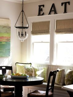 Traditional Meets Casual  Casual Dining    Sophisticated style mingles with kid-friendly ideas for an open living space that suits the whole family. A freestanding dining set paired with the window seat makes this breakfast nook highly functional. A vintage-style bench features a modern mix of fabrics and storage drawers for seldom-used linens and extra cookware