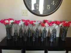 Flowers for zebra baby shower - repurpose bottles and use scrapbook paper to adapt to any theme