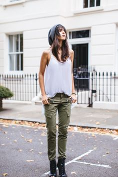 Grab a beanie a ruffled tank and a pair of military green... More