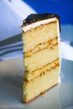Amazing Boston Cream Pie Layer Cake recipe with tender golden cake, pastry cream, white chocolate buttercream and decadent chocolate ganache! Perfect party cake!
