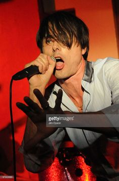 Brett Anderson of British group Suede performs live on stage during the first in a series of reunion concerts at The 100 Club on March 20, 2010 in London, England.